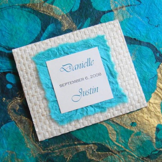 Hand crafted bamboo woven envelope with handmade paper and inside is a the place card that is custom...