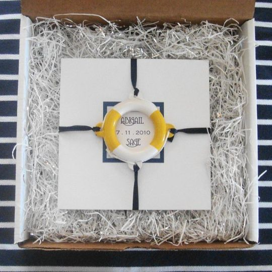 Nautical Wedding Invitation that is sea inspired and comes with a life ring embellishment.