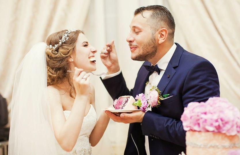 Feeding the bride some cake