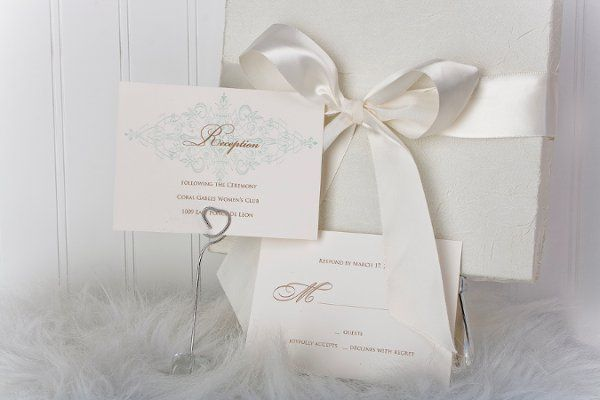 Outside view of silk covered box with satin ribbon. Matching reception and rsvp card complimented...