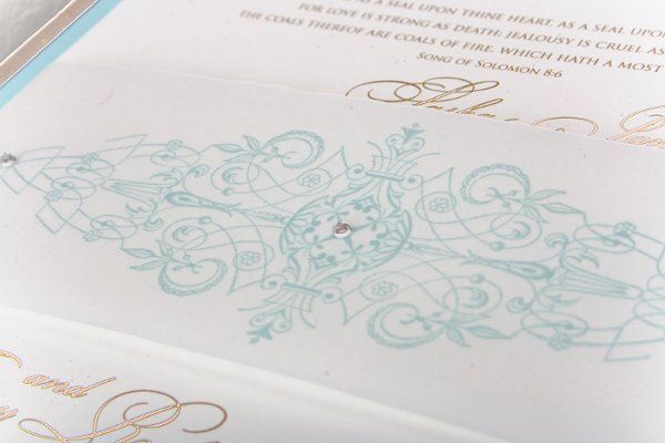 Three Swarovski crystals was precisely placed to highlight the scroll-like design printed on the...