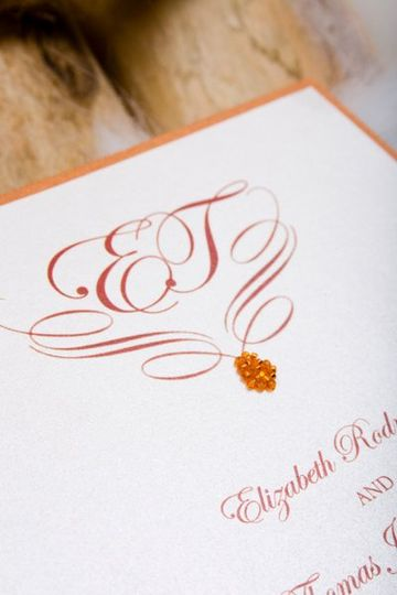 Custom designed 2 layer wedding invitation. Orange crystal seeds were miticulously glued to create a...