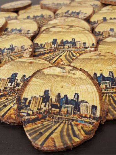 Wood slice ornaments featuring a photo of the couples favorite destination.