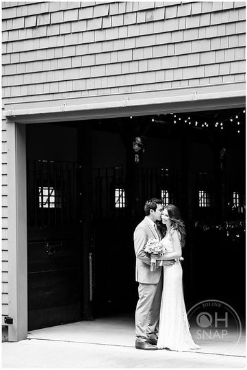 Groom giving his bride a kiss