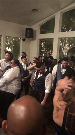 Groom and guests on the dance floor