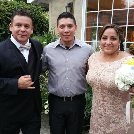 DJ with the groom and bride