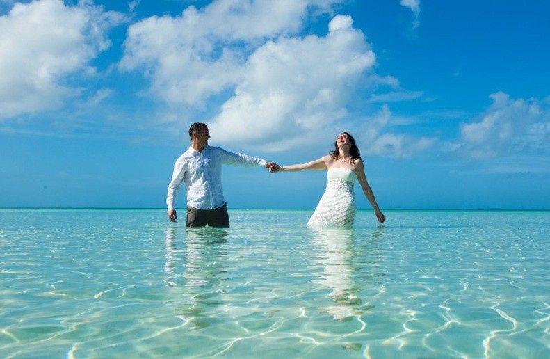 Chad + Elizabeth enjoying themselves at Eleuthera Bahamas Beach wedding