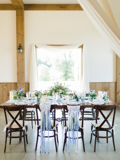 The drapes add a feminine touch to such a handsome interior.  Doesn't our farm table look great...