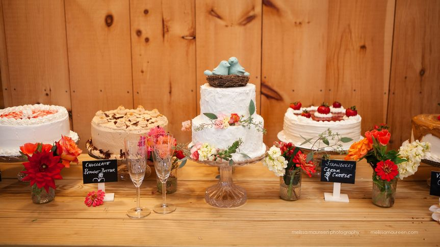 A cake buffet with a carrot cake and white chocolate cream cheese mini wedding cake! Stucco styled...