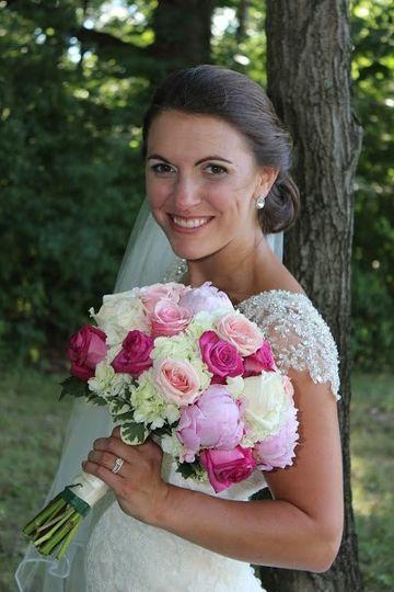Bride holding pink tone bouquet