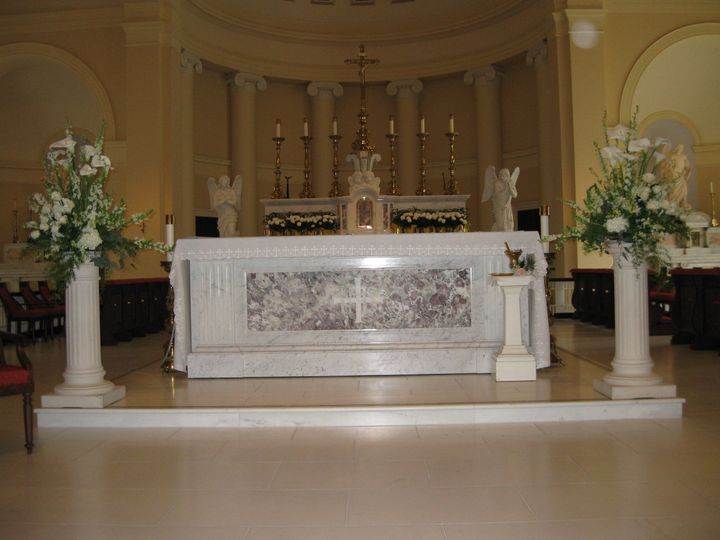 Formal all white ceremony with classic ceremony altar designs.