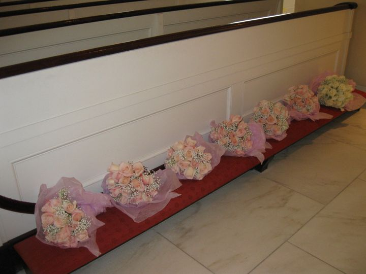 Bouquets are lined up waiting to be handed out.