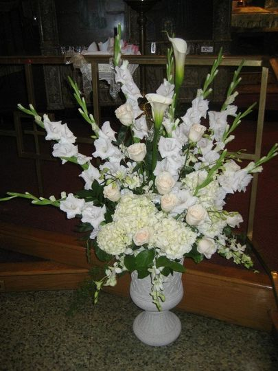 All white classic altar centerpieces for this traditional wedding.