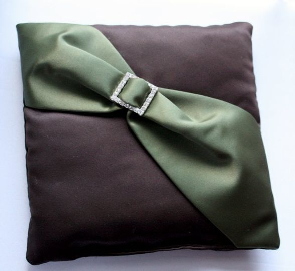 This ring pillow is made in chocolate brown matte satin with an olive matte satin diagonal sash with...