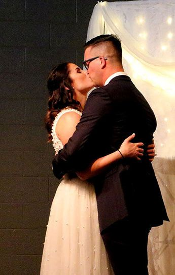 Sirie and Alex sharing a kiss as they become husband & wife at The Carlson.