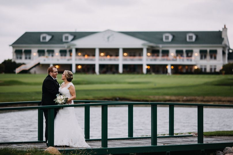Bride, groom, and clubhouse