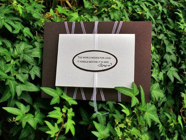 Purple/merlot folding wedding invitation wrapped with sheer white ribbon and designed with a...