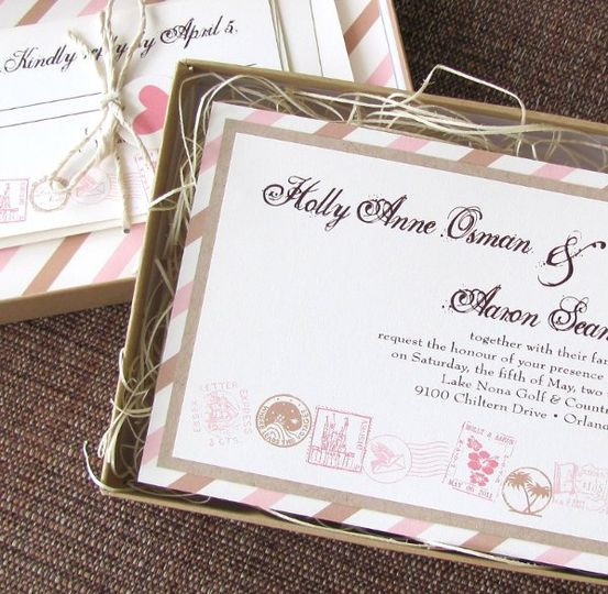 Destination wedding invitation in blush, taupe, and cream, served up in a kraft brown invitation...