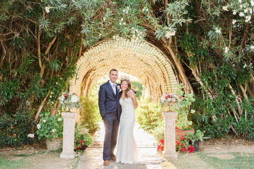 Newlyweds beneath arch