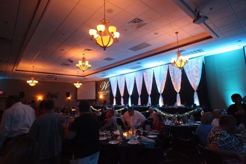 920 Events providing floor to ceiling backdrop for the head table.  Black satin, white chiffon with...