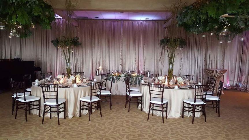 920 Events providing mahogany chiavari chairs, full length custom table linens, full fabric draping...