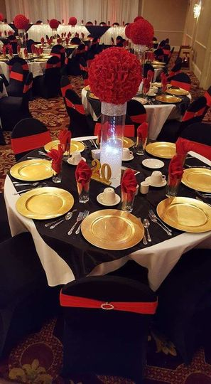 920 Events provided black overlays, gold plate chargers, gold table numbers, tall cylinder vases,...