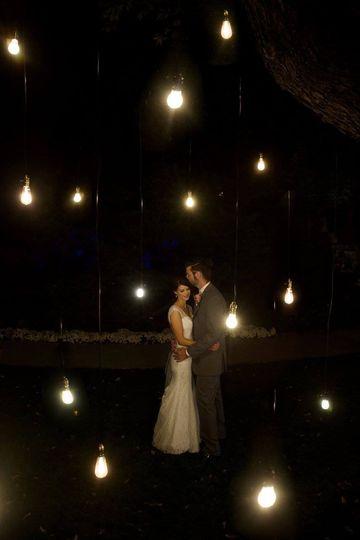 Newlyweds under the lights | Mollie Wetta Photography Venue:  Botanica in Wichita