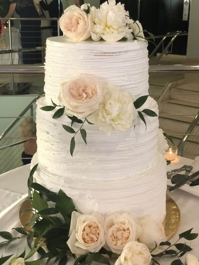 3-tiered cake with whipped cream frosting
