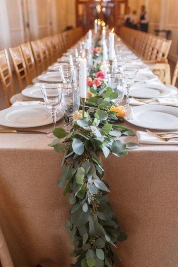 60 foot long live eucalyptus garland used as table runner. Greenery garland studded with pink,...