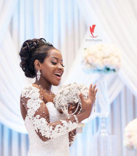 Bride holding bouquet & Backdrop