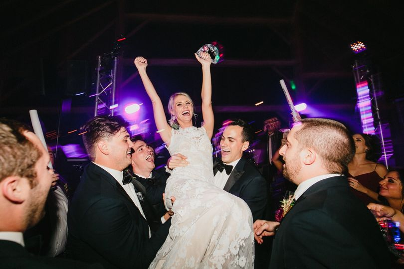 Lifting the happy bride!