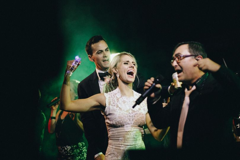 Newlyweds on stage with the vocalist
