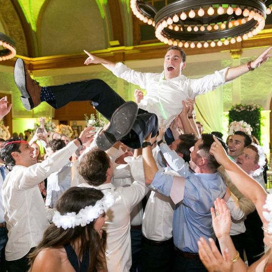 Lifting the excited groom