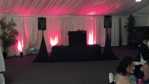 DJ set-up with accent lighting by Desert Music Entertainment DJs and Videography