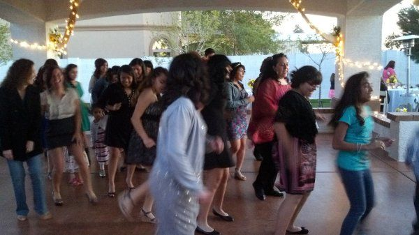 Guests dancing to a line dance at a reception, musical entertainment provided by Desert Music...