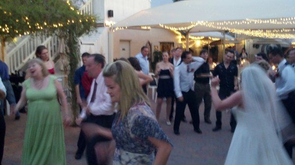 Guests dancing at wedding reception at the Antique Wedding House in Mesa, AZ.  Musical entertainment...