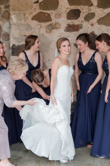 Bridesmaids helping the bride