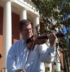 Playing violin in front of the Effingham County Courthouse.