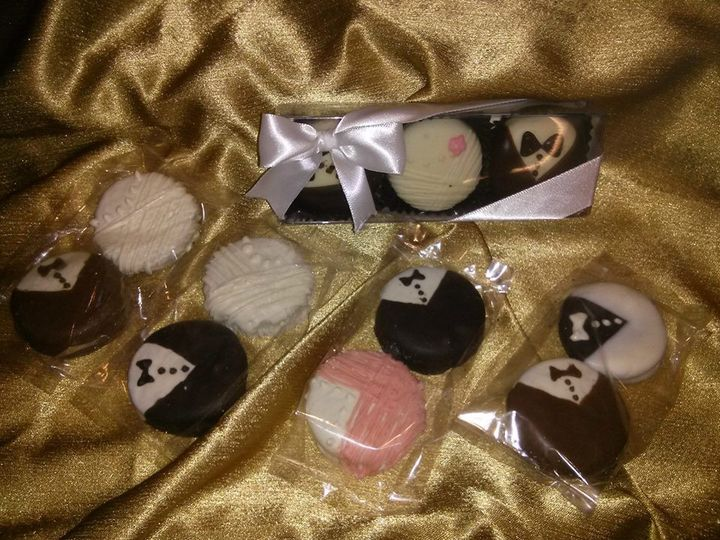 Our hand-dipped and decorated Bride & Groom oreos would make great favors - each guest could receive...
