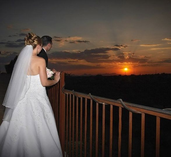 Bride and Groom enjoying the sunset at Saguaro Buttes.