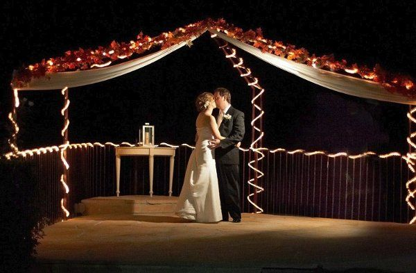 String lights illuminate the weddings site at night