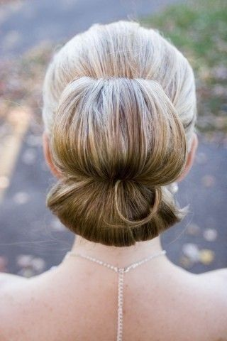 Sophisticated, Dramatic, modern Chignon with a twist.