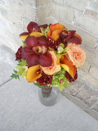 Bridal Bouquet of cymbidium orchids, hocus pocus and mango garden roses, hydrangeas, & flame mini...
