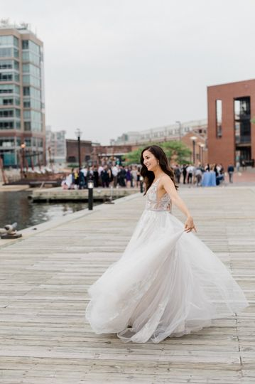Bride spinning in her beautiful gown