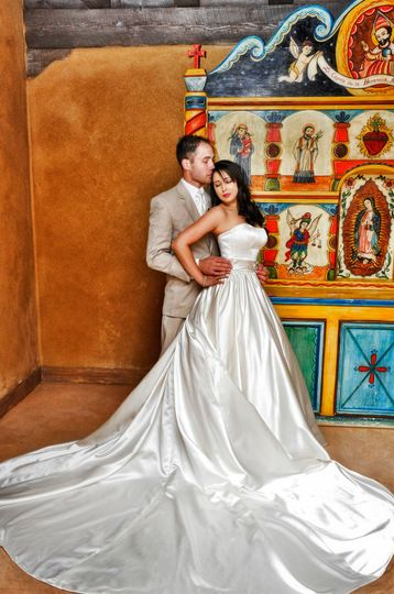 Bride and Groom in Southwestern Chapel with a custom alter screen by famous Santero Charlie...