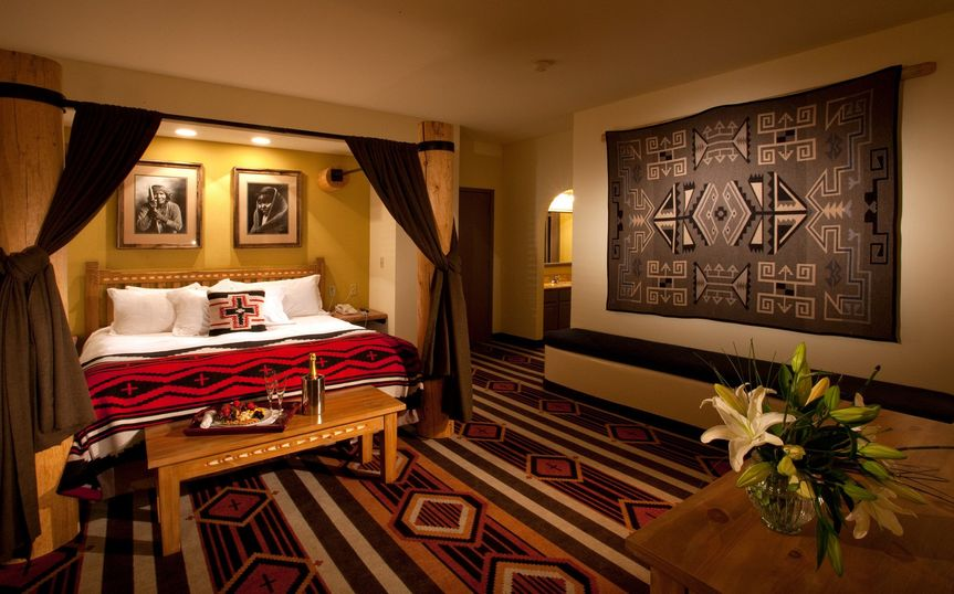 Guest room suite at the Lodge at Santa Fe features Kiva fireplace, kitchen and living room.