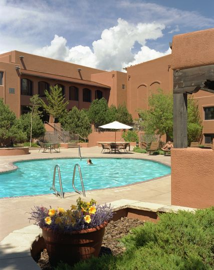 Outdoor pool with pool-side food and beverage service. Open seasonally.
