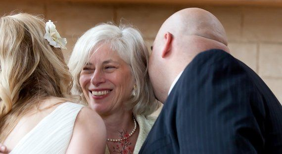 The smiling officiant