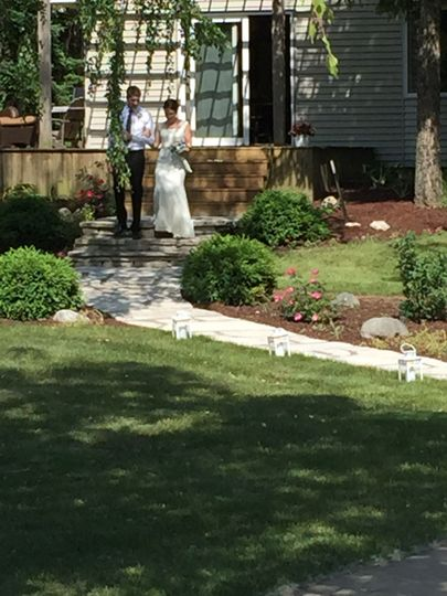 Brides typically walk down from house to the deck in front of the pond beside the waterfall
