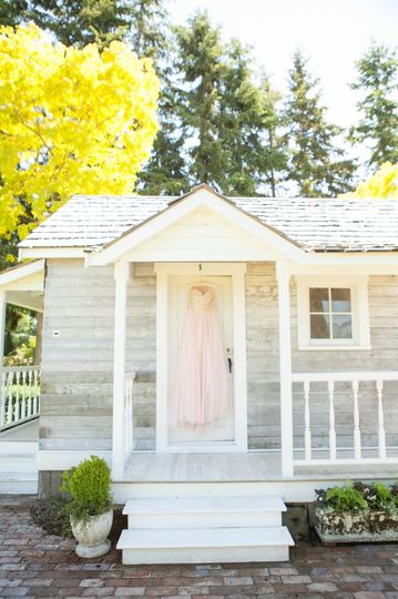 "Laura Nichols Photography hangs a bride's dress on our vintage bridal cottage as if to say, ""She's..."